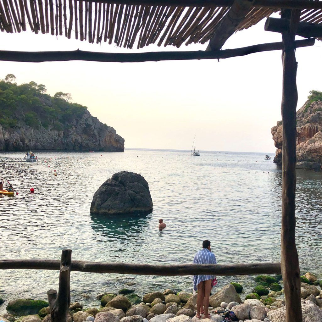 hidden beach coves in Deià
